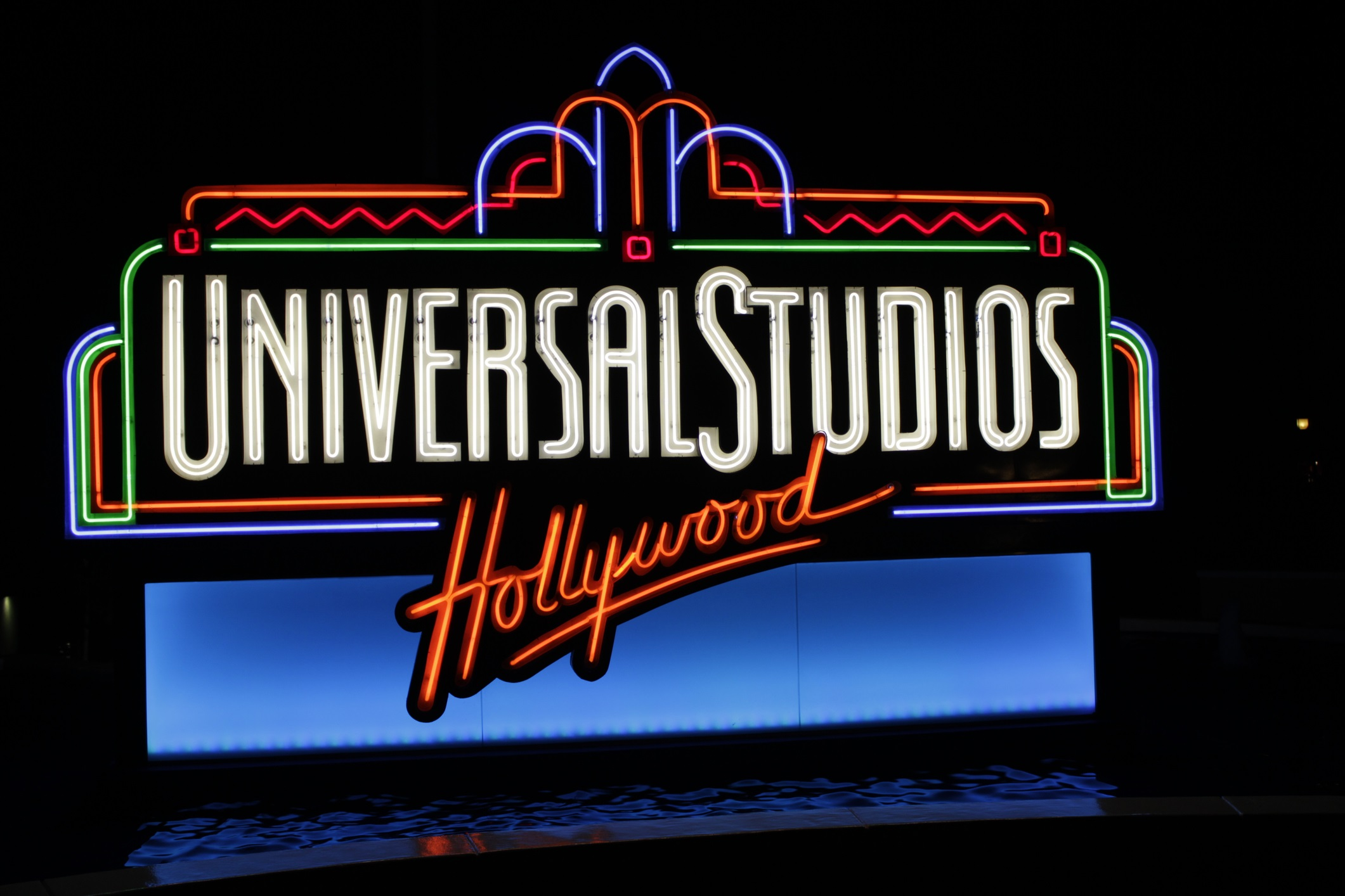 """Los Angeles, CA, USA - October 23rd, 2011: Universal Studios Hollywood neon sign at the entrance of the California theme park."""